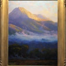 "American Legacy Fine Arts presents ""Morning Clouds Hovering Below Mount Blanca; Trinchera Ranch,Colorado"" a painting by Peter Adams."
